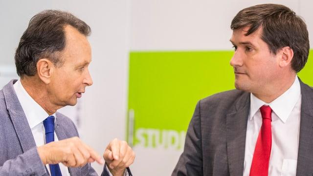 Philipp Müller da la PLD e Christian Levrat da la PS a chaschun da las davosas votaziuns ils 14 da zercladur.