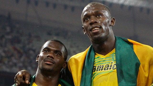 Usain Bolt und Staffelkollege Nesta Carter.