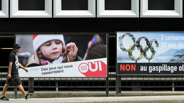 Ils placats pro e contra ils gieus olimpics Sion 2026.