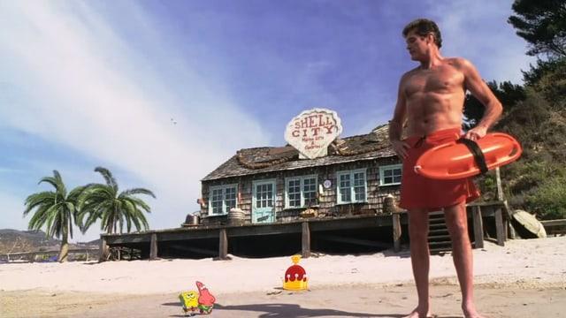 Mann am Strand.