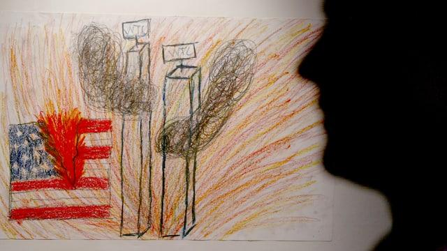 Kinderzeichnung vom brennenden World Trade Centre und einer amerikanische Flagge.