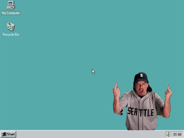 Ein grüngrauer Desktop-Hintergrund bekommt den Finger gezeigt.