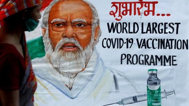 """Wandzeichnung von Narendra Modi und dem Text """"Das weltweit grösste Covid-19-Impfprogramm"""""""