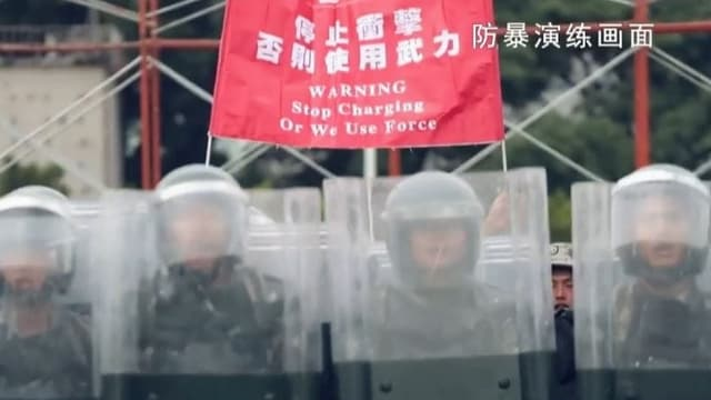 Ausschnitt aus Propaganda-Video zeigt Soldaten in Vollmontur gegen Demonstranten