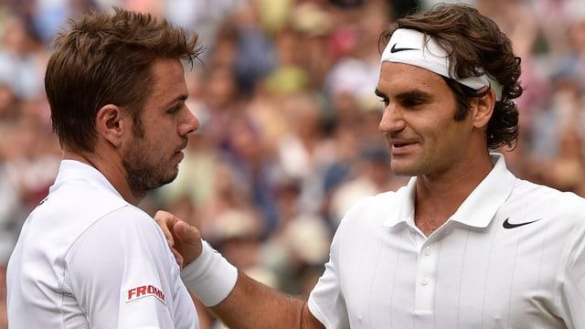 Stan Wawrinka und Roger Federer nach dem Wimbledon-Viertelfinal beim Handshake.