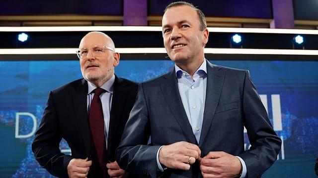 Frans Timmermans (links) und Manfred Weber (rechts) stehen nebeneinander.