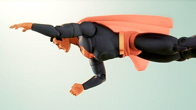 Eine Plastik-Spielfigur von Superman, die in der Luft hängt.