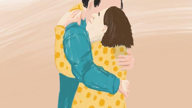 Eine Frau umarmt einen Mann.