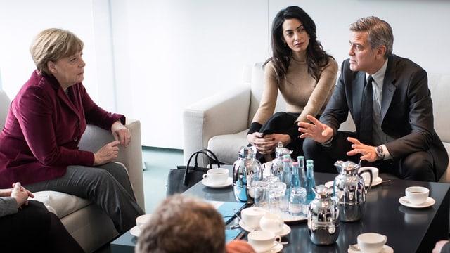George und Amal Clooney bekamen Gehör von Bundeskanzlerin Angela Merkel.