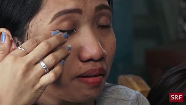 former household slave wipes tears from her eyes