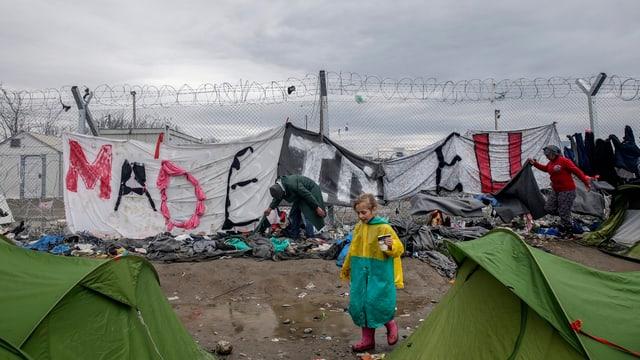 Flüchtlinge mit Transparent