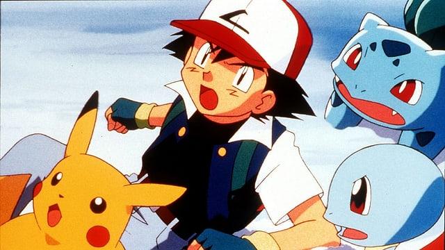 Szene aus der Pokémon-Anime-Serie: Drei Pokémon und ein Mensch.