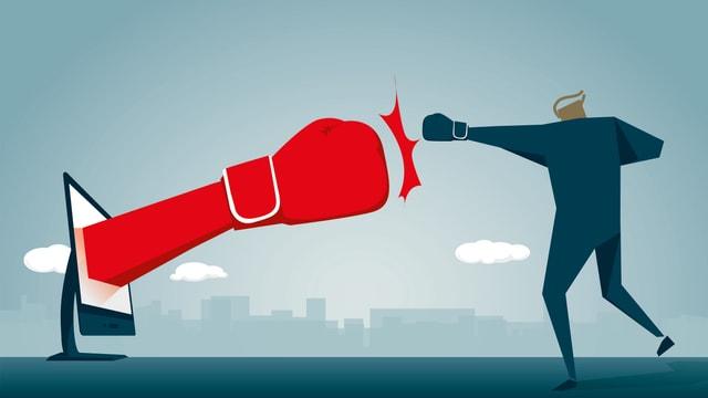 Zeichnung: Aus einem Bildschitm kommt eine Faust, ein Mann boxt dagegen.