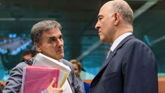 Griechenlands Finanzminister Tsakalotos und EU-Währungskommissar Moscovici vor dem Euro-Gruppen-Treffen.