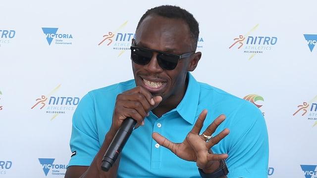 Usain Bolt durant ina conferenza da medias.