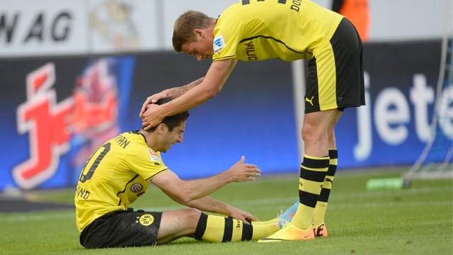 Henrich Mchitarjan (l.) verletzt sich im Spiel gegen den FC Luzern.