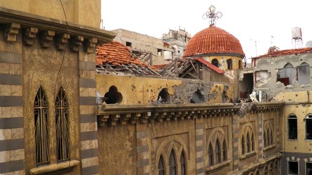 Eine beschädigte Kirche in Homs.
