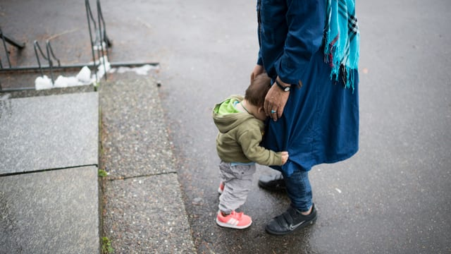 Frau mit Kind.