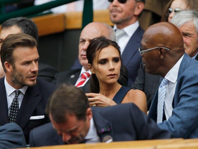 David und Victoria Beckham unterhalten sich mit Samuel L. Jackson.