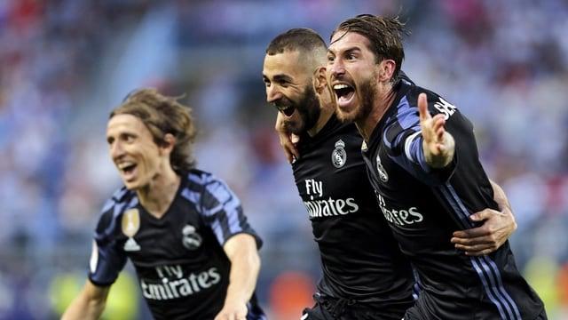 Luka Modric, Karim Benzema und Sergio Ramos jubeln.