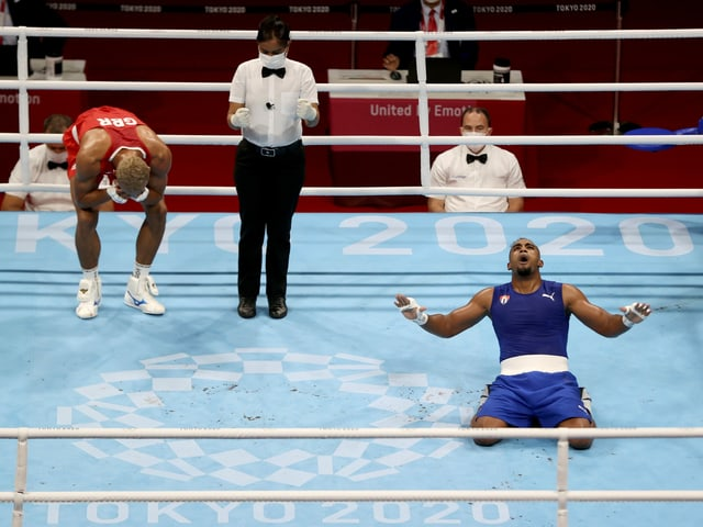 """Tokyo 2020 Olympics - Boxing - Men's Light Heavyweight - Final - Kokugikan Arena - Tokyo, Japan - August 4, 2021 - Arlen Lopez Cardona of Cuba and Benjamin Whittaker of Britain react after their fight. REUTERS/Carl Recine/File photo SEARCH """"BEST OF THE TOKYO OLYMPICS"""" FOR ALL PICTURES. TPX IMAGES OF THE DAY."""