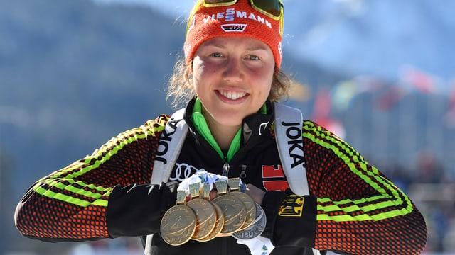Tschintg medaglias d'aur per Laura Dahlmeier.