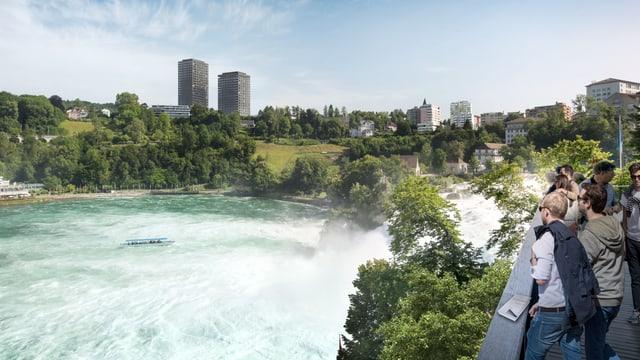 Touristen Blicken auf Rheinfall mit Hochhäusern im Hintergrund.