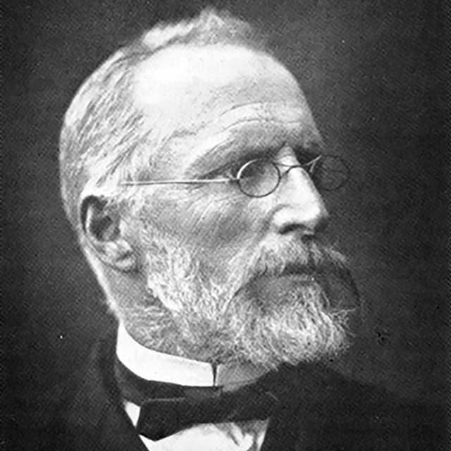 Foto eines älteren Mannes mit Fliege und Brille.