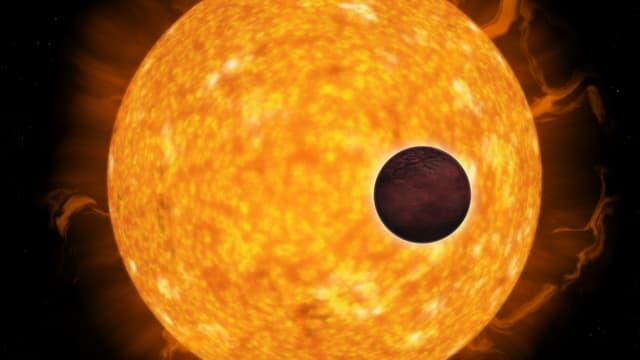 Ein dunkler Planet vor einem gelben Stern