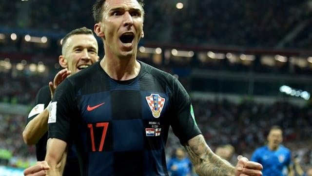 Il giugader Croat Mario Mandžukić celebrescha ses gol.