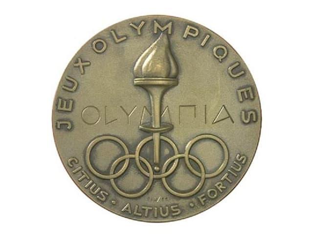 Medaglia dals gieus olimpics 1952 ad Oslo cun ils motto olimpic.