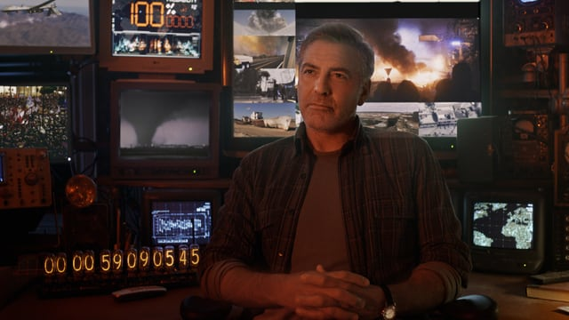 George Clooney vor vielen Bildschirmen