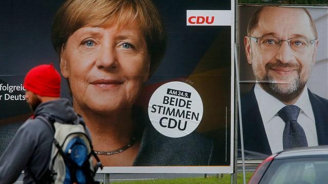 Purtret da placats da votaziun da Merkel e Schulz.
