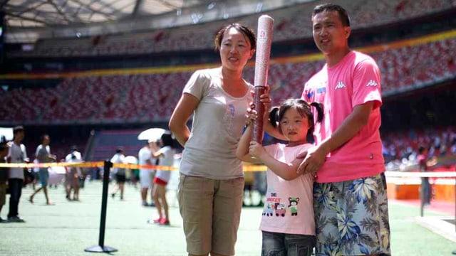 Chinesische Eltern mit einem Kind