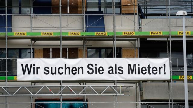 Transparent an einem Neubau: Wir suchen Sie als Mieter!
