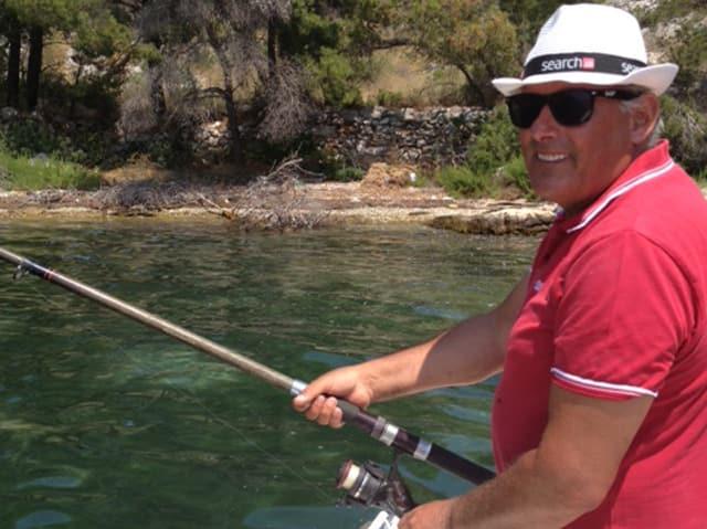 Eduard Rutschmann beim Fischen