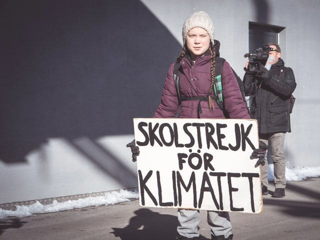 Greta cun ses placat da protest