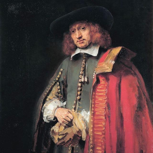 Ein Kaufmann mit rotem Mantel.