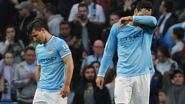Die beiden City-Spieler Sergio Aguero (links) und Joleon Lescott nach der Niederlage.