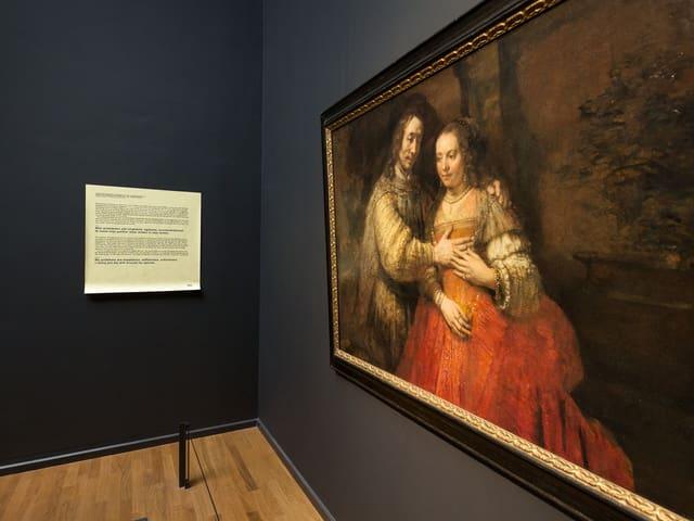 Ein Gemälde: Ein Mann umarmt eine Frau. De Bottons Post-It dazu: «Meine Probleme sind Ungeduld, Selbstsucht und Lieblosigkeit. Ich umarme meine Frau nur selten.»