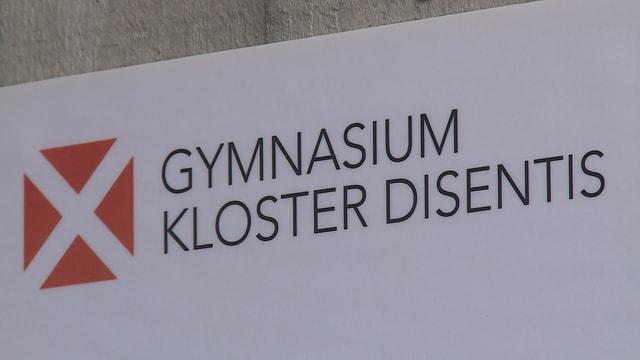 Tavla cun il logo da la scola claustrala da Mustér