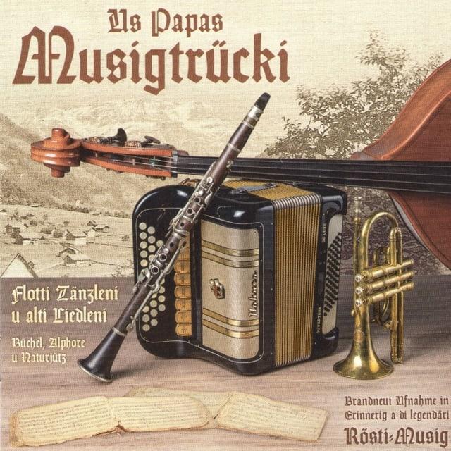 Klarinette, Handharmonika, Bassgeige und Cornett auf einem Plattencover.