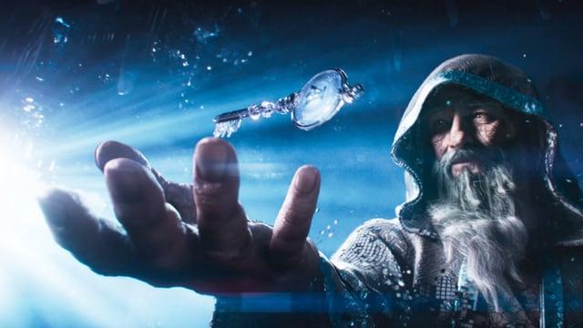 Von links ein alles überstahlender Schein aus einem Punkt. Rechts steht ein Mann mit langem Bart und Kapuze, er streckt die Hand nach einem schwebenden Schlüssel aus. Hand und Schlüssel sind im Vordergrund.