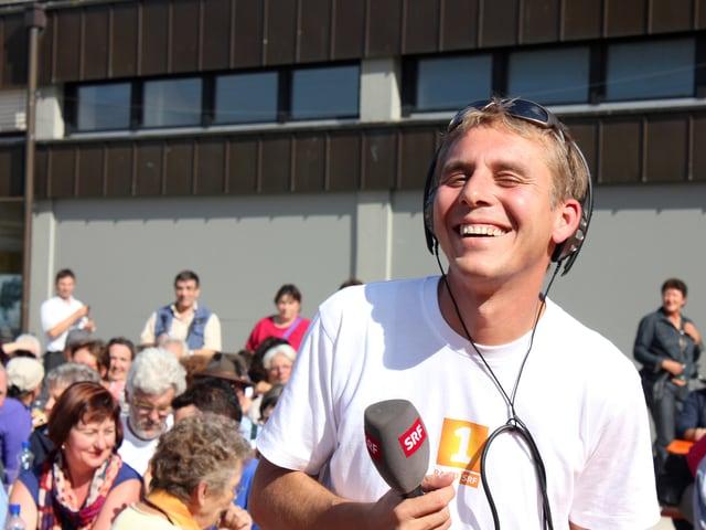 Reto Scherrer lacht auf dem Festgelände in Rheinfelden.