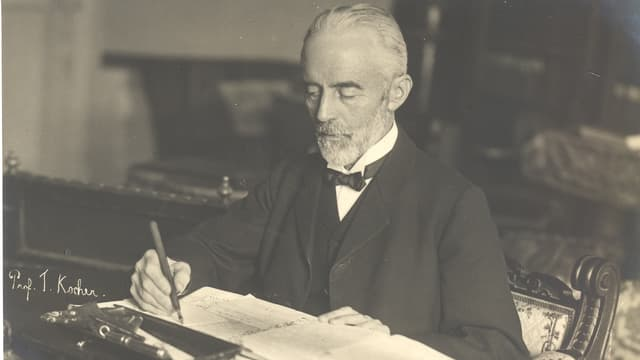 Theodor Kocher beim Verfassen einer Schrift.