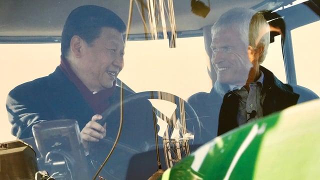 Sojabohnen-Farmer Rick Kimberley und Xi Jinping im Traktor.