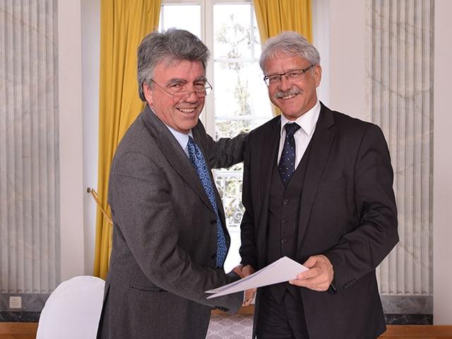 ETH Lausanne-Direktor Patrick Aebischer mit dem Freiburger Volkswirtschaftsdirektor Beat Vonlanthen.