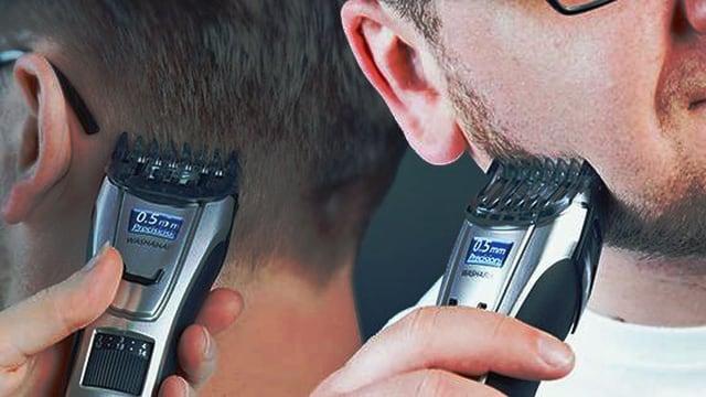 Nahaufnahmen eines Trimmers beim Bart schneiden und beim Nacken schneiden.