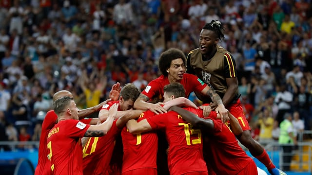 Ils giugaders da la Belgia sa legran sur da lur victoria.
