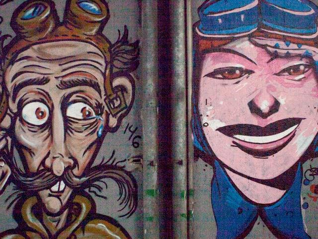 Ein Graffiti eines weiblichen Gesichtes. Das zweite von einem dünnen Mann.